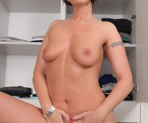 Pound legged brunette Danni Stash away posing with spread pussy bazoo almost the closet