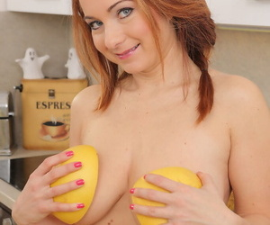 Hot full-grown housewife soaks her chunky melons all over grapefruit juice all over the kitchenette
