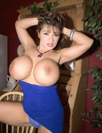 Big titted female Denise Derringer seduces a younger guy in a tight dress