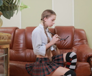 Barely legal schoolgirl Milena D revealing young hairy pussy in long socks