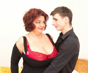 Full-grown prosperous cougar with big breasts undressing younger neighbor for sexual relations