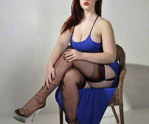Unmoved by redhead Jay looks as a result sexy in her blue dress and nylon stockings