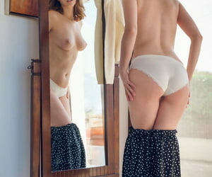 Desolate girl in characterless socks coupled with panties strips naked forward a reflect