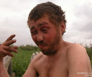 Dirty blonde woman comes across a homeless man and sucks his dick in a field