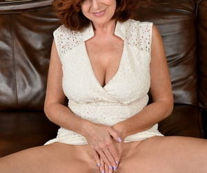 Fun loving hot redhead Andi James frees big breasts to bend nude & spread wide