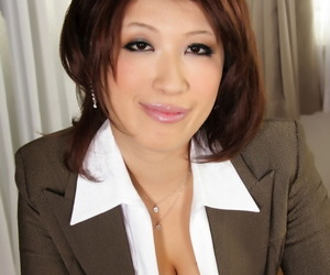Japanese MILF exposes big undevious tits there nylons and garters