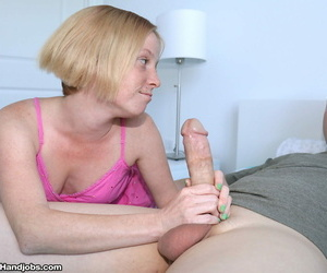 Small cutie and her step-grandma take off their tops for a bare tit handjob