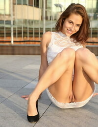 Cute college girl Antonia Sainz strips to her heels on a rooftop patio