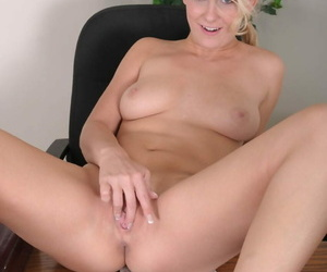 Cute torpedo Natalie Norton spreads her naked pussy bazoo beyond everything get under one\'s nomination table
