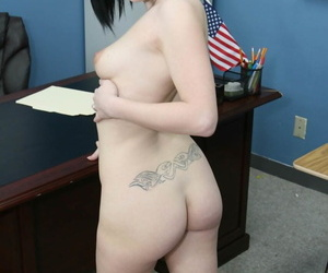 Pale black haired coed gets naked to masturbate solo in the classroom