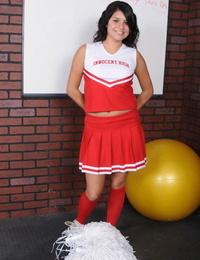 Dark haired cheerleader Christina Moure strips from her uniform