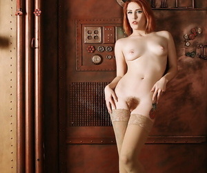 Sexy redhead Anastassia Bear strikes great solo poses in flesh toned hosiery