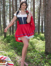 Teen amateur removes a Little Red Riding Hood outfit to get naked in the woods