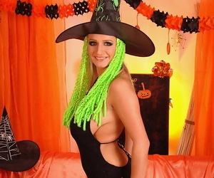 Big titted blonde Jannete toys her pussy wearing a witch outfit