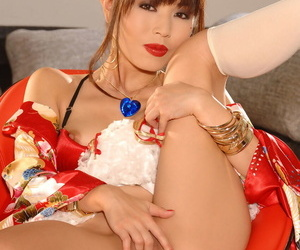 Cute Japanese Marica Hase teases in bathrobe before fingering the brush delicious twat