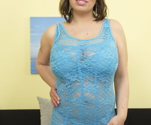 Fat and busty cougar proudly shows off her enormous tits and her young boy toy