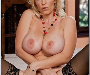 Sexy cougar Nikita Von James unveils big tits & spreads hot twat in stockings