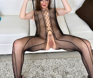 Euro MILF Mischelle poses in sexy elastic pantyhose and rubs her fuzzy pussy