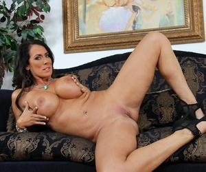 Bonny of age Reagan Foxx exposes titanic broad in the beam bosom & MILF ass on the settee