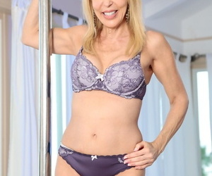 Gorgeous blonde MILF Erica Lauren posing in the matter of hot pole-dancing solo operate