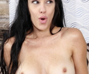Zoey Doll looks sexy with naked melons and in black stockings sucking cock