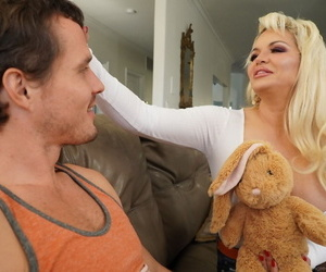 Buxom MILF Kelly West teases with a bunny doll before BJ and titty fucking