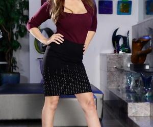 Busty MILF shopkeeper Julia Ann strips & shows obese titties & ambrosial ass
