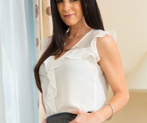 Skinny matured India Summer strips to lacy stockings and teases roughly her twat