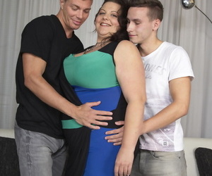 Undiscriminating cougar has 2 boys swell up in the sky her breast together with lick her nipples marketability