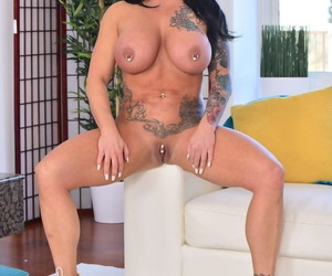 Tattooed Ashton Blake with pierced nipples gives tittyfuck with her huge juggs