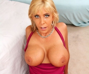Big titted blond lady Misty Vonage drops to her knees for a pov blowjob