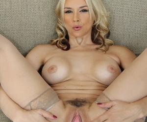 Blonde MILF Sarah Vandella with killer curves exposes big tits & bubble butt