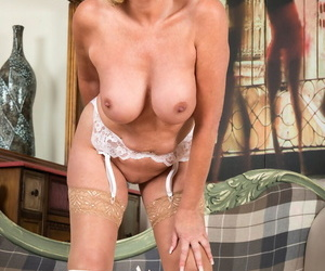 Stunning mature Amy Goodhead removes her red dress added to showcases her curves