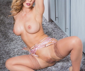 Salacious housewife Cherie DeVille removes her robe and reveals her big boobs