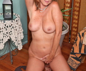 Horny mature with amazing body Jodi West strips and masturbates in a solo