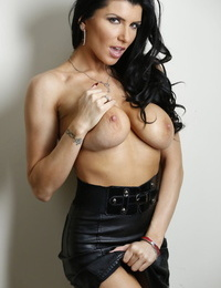 Busty hot pornstar Romi Rain removes leather skirt to get stud cum on pussy