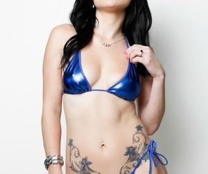 Dark haired pornstar Veruca James shucks her bikini aside before anal sex