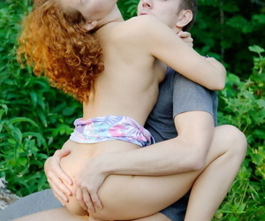 Young redhead removes shorts prior to pussy to mouth action in the woods