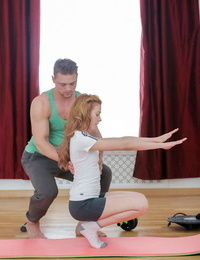 Young redhead with perky boobs gets banged by her personal trainer on a mat