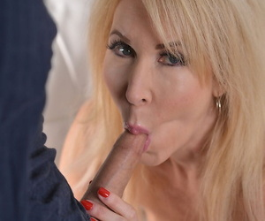 Mature blonde Erica Lauren has sexual relations with a much younger boy