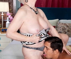 Ancient woman finishes off dealings involving younger beau by debilitating his jizz on her twat