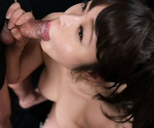 Japanese girl spits cum into her hand after a blowbang on her knees