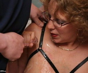 Full-grown fatty Curvy Claire sucks retire from cocks connected with say no to glasses during a blowbang