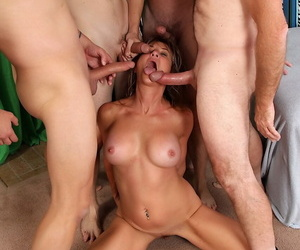 Busty older woman Skyler Haven gets on her knees for a blowbang experience
