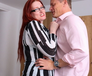 Mature redhead plumper removes her glasses during hardcore sex with her hubby