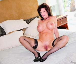 Busty older lady Deauxma jacks a cock after fucking missionary style