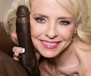 Mature woman Cammille Austin got the biggest black dick in her life in the ass