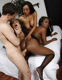 Attractive ebony girlfriends in sexy lingerie love group sex with a white guy