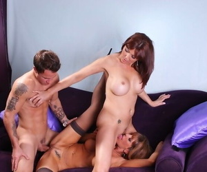 Fervent MILFs Desi Foxx and Rachel Rivers getting off in a threesome