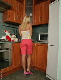 Young blonde Alina loses her virginity with the neighbours boy in the kitchen